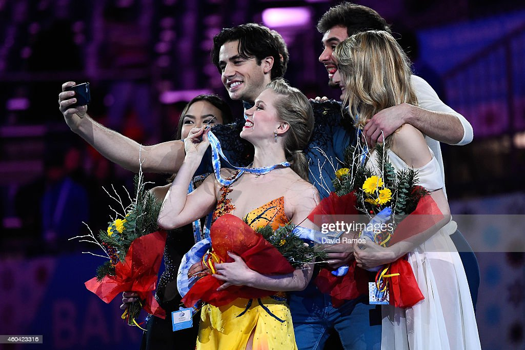 Madison Chock and Evan Bates of USA, Kaitlyn Weaver and Andrew Poje of Canada and Gabriella Papadakis and Guillaume Cizeron of France make a selfie during the medals ceremony during day three of the ISU Grand Prix of Figure Skating Final 2014/2015 at Barcelona International Convention Centre on December 13, 2014 in Barcelona, Spain.