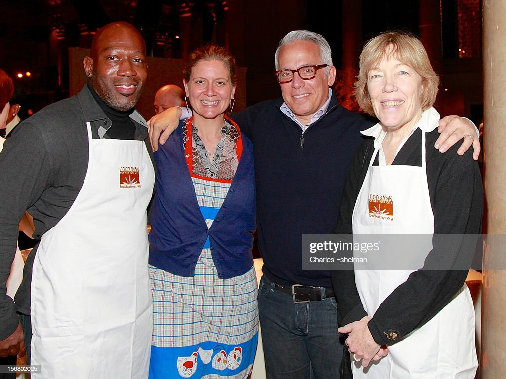 Madison Cowan, Amanda Freitag, Geoffrey Zakarian and Brooke Bailey Johnson volunteer during the Our Table Is Yours - A Thanksgiving Day benefit at Cipriani, Wall Street on November 21, 2012 in New York City.