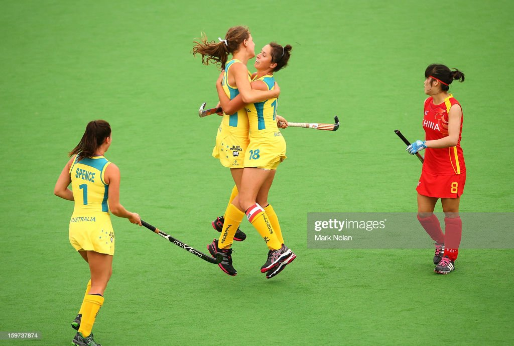 Madison Fitzpatrick and Kate Gilmore of Australia celebrate a goal by Fitzpatrick in the Women's Hockey Final between Australia and China at Sydney Olympic Park Hockey Centre on January 20, 2013 in Sydney, Australia.