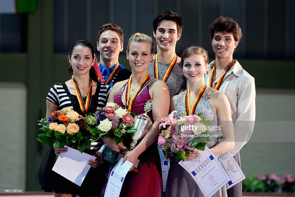 Madison Hubbel and Zachary Donohue of the United States, Ksenia Monko and Kirill Khaliavin of Russia and Alexandra Paul and Mitchell Islam of Canada pose with the trophy after the Ice Dance Free Dance competition during day three of the ISU Nebelhorn Trophy at Eissportzentrum Oberstdorf on September 28, 2013 in Oberstdorf, Germany.