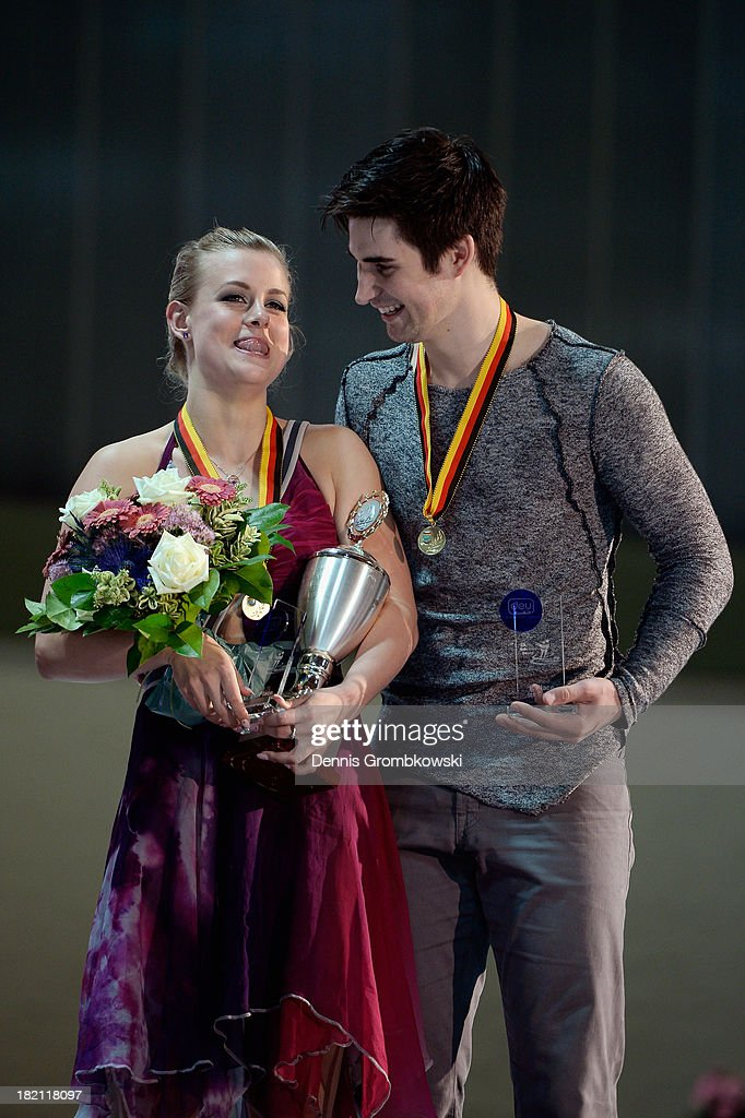 Madison Hubbel and Zachary Donohue of the United States pose with the trophy after the Ice Dance Free Dance competition during day three of the ISU Nebelhorn Trophy at Eissportzentrum Oberstdorf on September 28, 2013 in Oberstdorf, Germany.