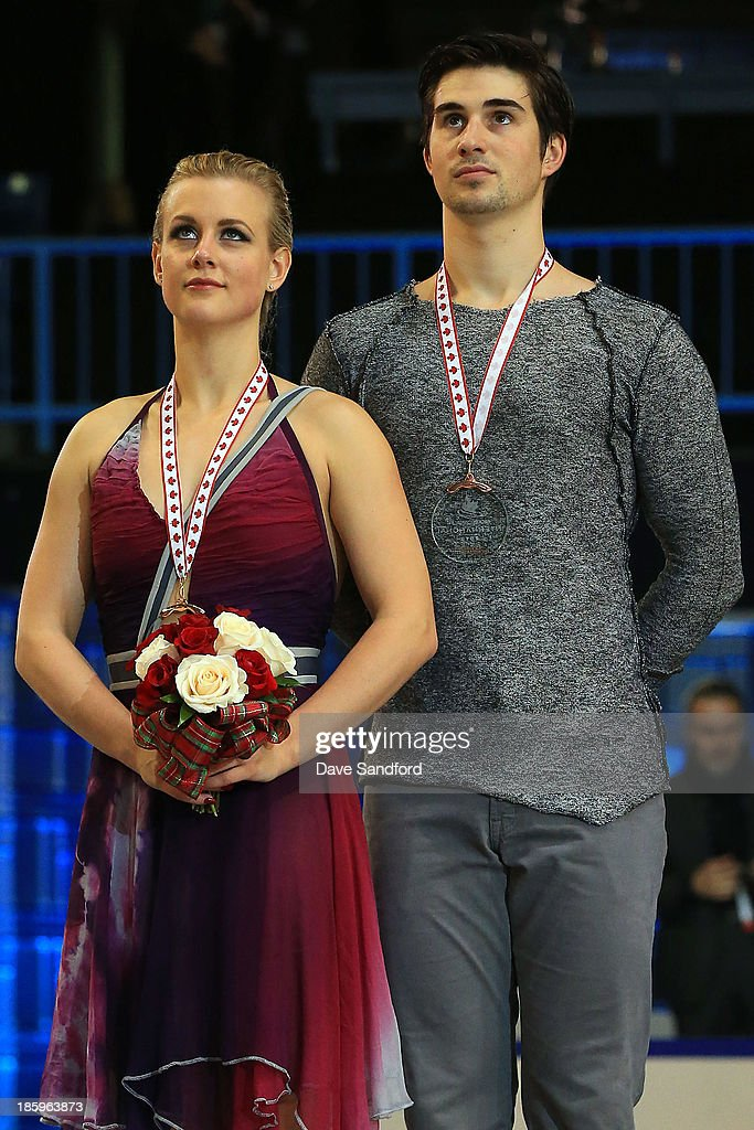 Madison Hubbell (L) and Zachary Donohue of the United States celebrate their bronze medal win in the ice dance free program on day two at the ISU GP 2013 Skate Canada International at Harbour Station on October 26, 2013 in Saint John, New Brunswick, Canada.