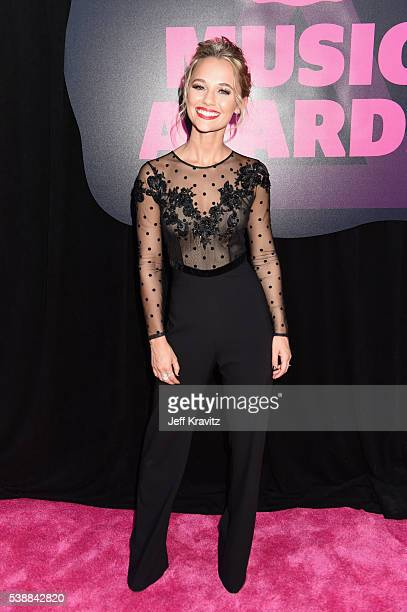 Madison Iseman attends the 2016 CMT Music awards at the Bridgestone Arena on June 8 2016 in Nashville Tennessee