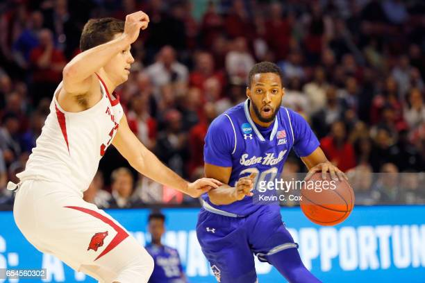 Madison Jones of the Seton Hall Pirates drives against Dusty Hannahs of the Arkansas Razorbacks in the second half in the first round of the 2017...