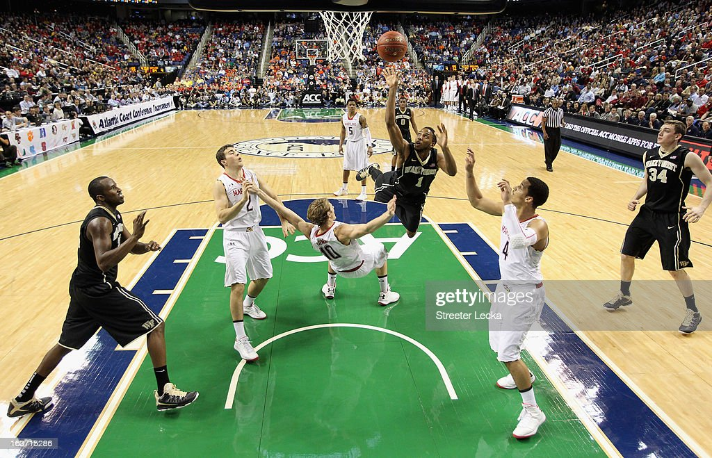 Madison Jones #1 of the Wake Forest Demon Deacons shoots over Jake Layman #10 of the Maryland Terrapins during the first round of the Men's ACC Basketball Tournament at Greensboro Coliseum on March 14, 2013 in Greensboro, North Carolina.