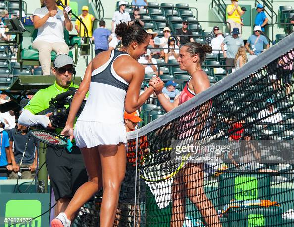 Madison Keys celebrates winning a match against Roberta Vinci of Italy during Day 7 of the Miami Open presented by Itau at Crandon Park Tennis Center...