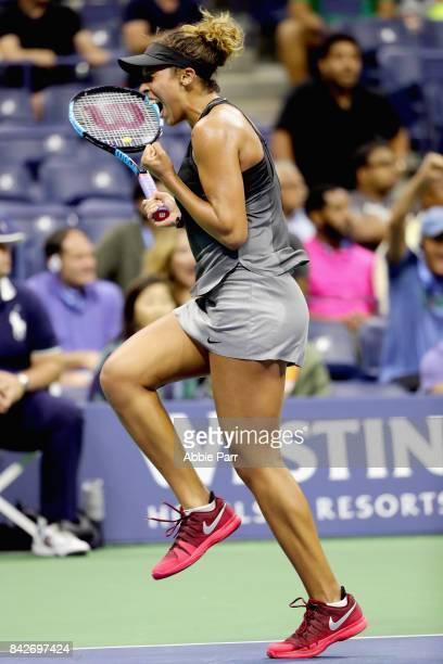 Madison Keys of the United States celebrates match point against Elina Svitolina of Ukraine during their women's singles fourth round match on Day...