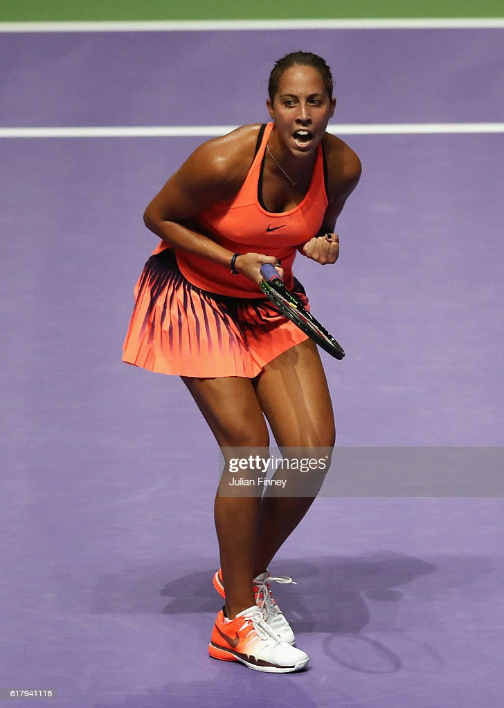 Madison Keys of the United States celebrates victory in her singles match against Dominika Cibulkova of Slovakia during day 3 of the BNP Paribas WTA Finals Singapore at Singapore Sports Hub on October 25, 2016 in Singapore.