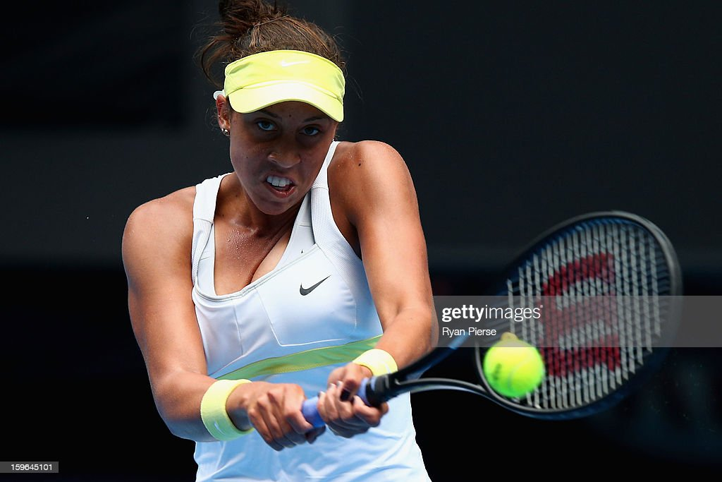 Madison Keys of the United States of America plays a backhand in her third round match against Angelique Kerber of Germany during day five of the 2013 Australian Open at Melbourne Park on January 18, 2013 in Melbourne, Australia.