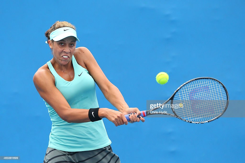 Madison Keys of the United States plays a backhand in her second round doubles match with Alison Riske of the United States against Kristina Mladenovic of France Flavia Pennetta of Italy during day six of the 2014 Australian Open at Melbourne Park on January 18, 2014 in Melbourne, Australia.