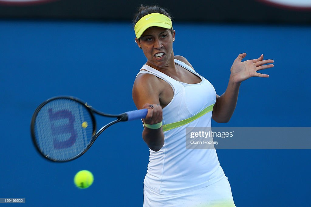 Madison Keys of the United States plays a forehand in her first round match against Casey Dellacqua of Australia during day one of the 2013 Australian Open at Melbourne Park on January 14, 2013 in Melbourne, Australia.