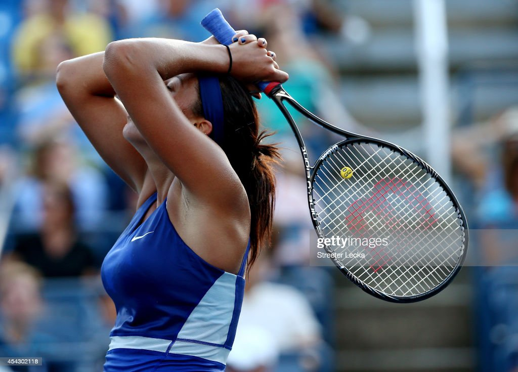 <a gi-track='captionPersonalityLinkClicked' href=/galleries/search?phrase=Madison+Keys&family=editorial&specificpeople=5965706 ng-click='$event.stopPropagation()'>Madison Keys</a> of the United States reacts against Aleksandra Krunic of Serbia during their women's singles second round match on Day Four of the 2014 US Open at the USTA Billie Jean King National Tennis Center on August 28, 2014 in the Flushing neighborhood of the Queens borough of New York City.