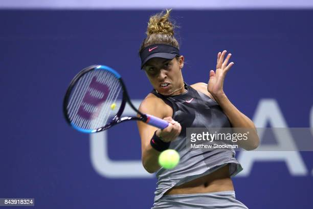 Madison Keys of the United States returns a shot against CoCo Vandeweghe of the United States during their Women's Singles Semifinal match on Day...