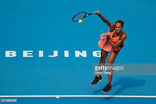 Madison Keys of the United States returns a shot against Duan Yingying of China during the Women's singles first round match on day two of the 2016...