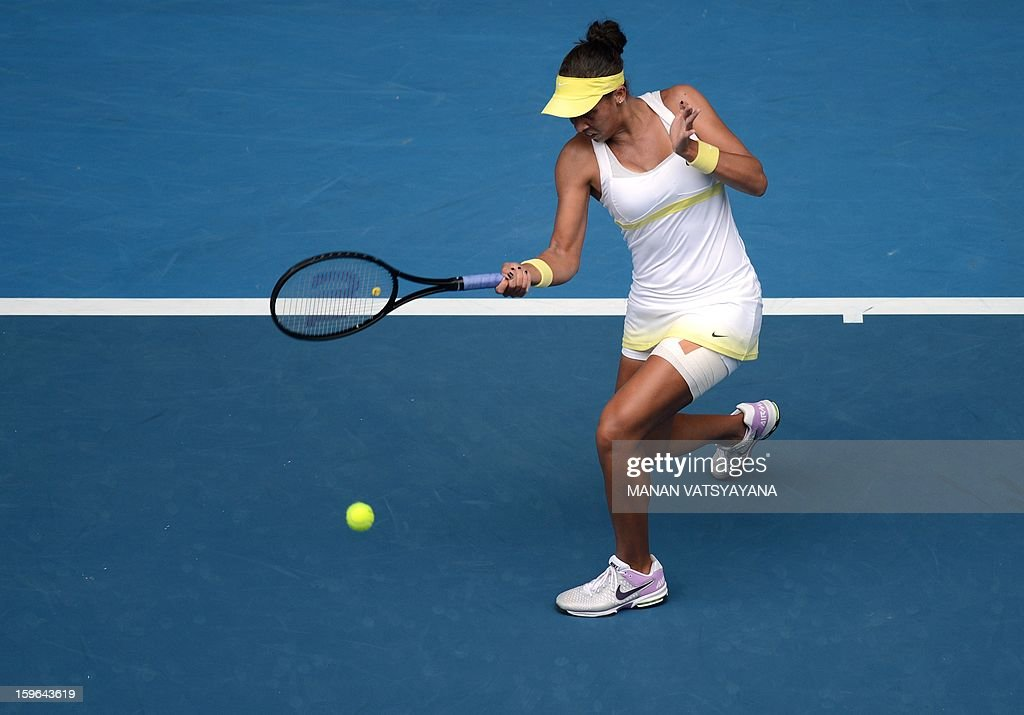 Madison Keys of the US hits a return against Germany's Angelique Kerber during their women's singles match on day five of the Australian Open tennis tournament in Melbourne on January 18, 2013.