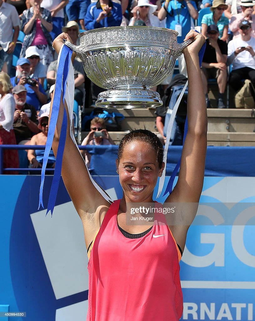 <a gi-track='captionPersonalityLinkClicked' href=/galleries/search?phrase=Madison+Keys&family=editorial&specificpeople=5965706 ng-click='$event.stopPropagation()'>Madison Keys</a> of USA celebrates with the trophy after beating Angelique Kerber of Germany during their Women's Finals match on day eight of the Aegon International at Devonshire Park on June 21, 2014 in Eastbourne, England.