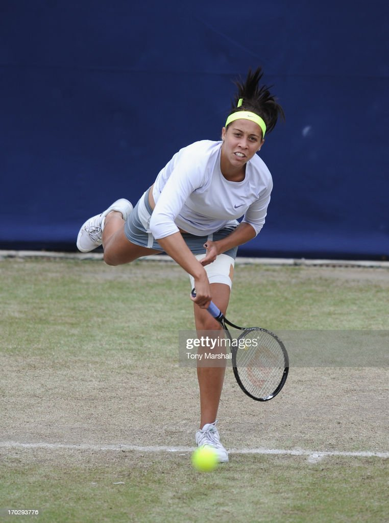 <a gi-track='captionPersonalityLinkClicked' href=/galleries/search?phrase=Madison+Keys&family=editorial&specificpeople=5965706 ng-click='$event.stopPropagation()'>Madison Keys</a> of USA serves to Lesia Tsurenko of Ukraine during the first round of The AEGON Classic Tennis Tornament at Edgbaston Priory Club on June 10, 2013 in Birmingham, England.