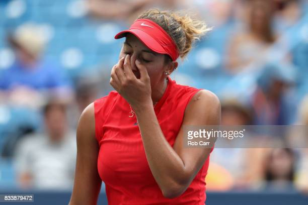 Madison Keys reacts to a shot against Garbine Muguruza of Spain during Day 6 of the Western and Southern Open at the Linder Family Tennis Center on...