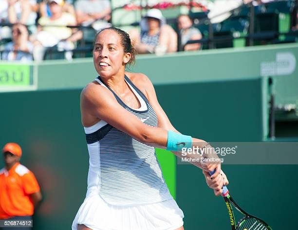 Madison Keys returns a background during her match against Roberta Vinci of Italy during Day 7 of the Miami Open presented by Itau at Crandon Park...