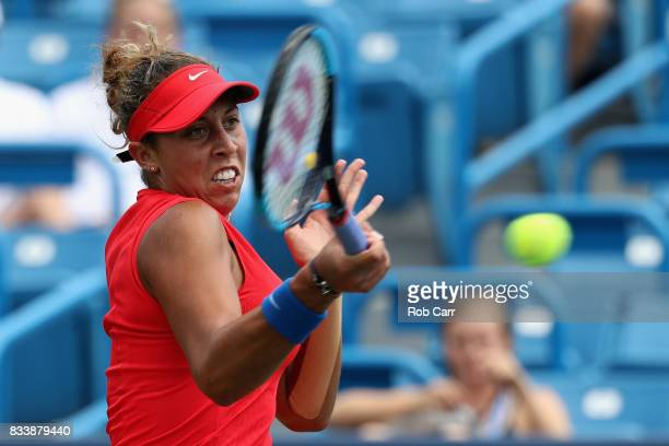 Madison Keys returns a shot to Garbine Muguruza of Spain during Day 6 of the Western and Southern Open at the Linder Family Tennis Center on August...