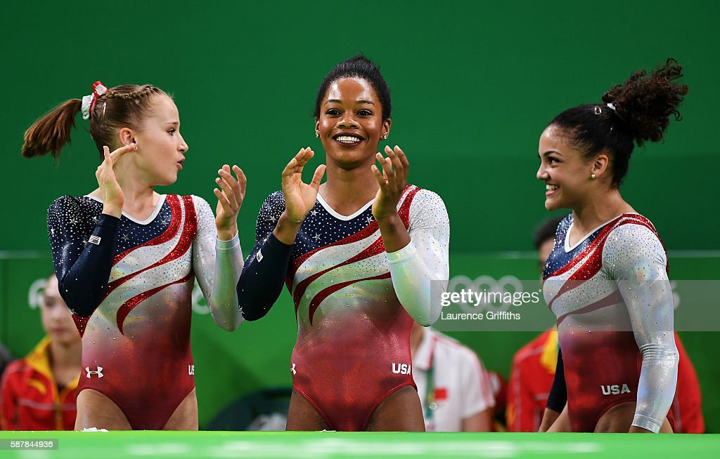 Madison Kocian (L), Gabrielle Douglas (C) and Lauren Hernandez (R) of the United States congratulate after Alexandra Raisman competing on the floor during the Artistic Gymnastics Women's Team Final on Day 4 of the Rio 2016 Olympic Games at the Rio Olympic Arena on August 9, 2016 in Rio de Janeiro, Brazil.