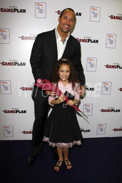 Madison Pettis And Dwayne The Rock Johnson Attend The Game