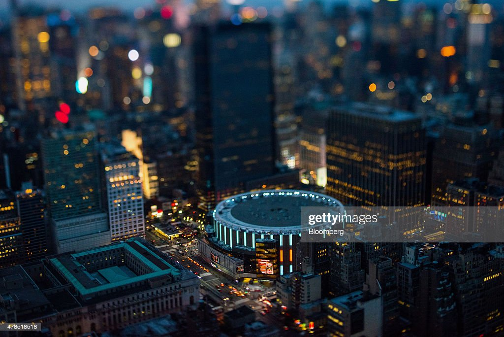 Madison Square Garden stands in Manhattan at dusk in this aerial photograph taken with a tiltshift lens above New York US on Friday June 19 2015 The...