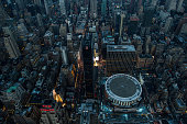 Madison Square Garden stands in Manhattan at dusk in this aerial photograph taken above New York US on Friday June 19 2015 The Standard Poor's 500...