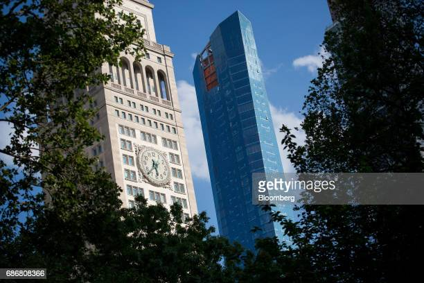 Madison Square Park Tower right stands next to the Metropolitan Life Insurance Company Clock Tower in the Flatiron District of New York US on...