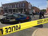 Madison Street is blocked by police due to a barricade situation on May 20 2015 in Baltimore Md Children were extracted at the scene and at least one...
