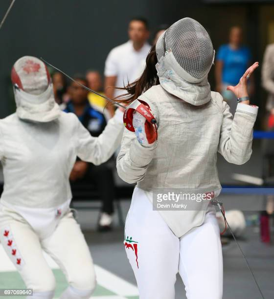 Madison Thurgood of Canada fences against Julieta Toledo of Team Mexico during semifinal action in the Team Women's Sabre event on June 17 2017 at...