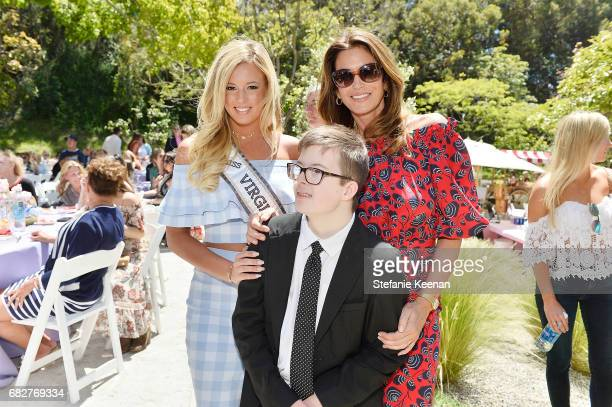 Madison Walker Brian Walker and Cindy Crawford attend Cindy Crawford and Kaia Gerber host Best Buddies Mother's Day Brunch in Malibu CA sponsored by...