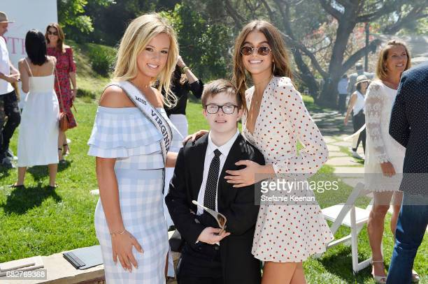 Madison Walker Brian Walker and Kaia Gerber attend Cindy Crawford and Kaia Gerber host Best Buddies Mother's Day Brunch in Malibu CA sponsored by...