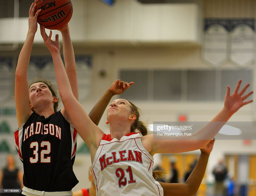 Madison's Aidan McWeeney, left, garbs a rebound against McLean's Louisa Murphy as Madison defeats McLean 48 - 46 in the Virginia AAA Liberty District girls basketball tournament finals at South Lakes High School in Reston VA, February 15, 2012 .