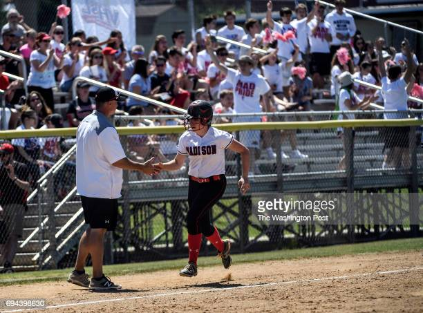 Madison's Alex Echazarreta heads to home after rounding third on a two run home run during the Virginia 6A State Softball Semifinal game between...
