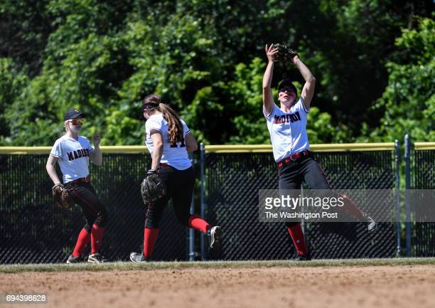 Madison's Emily Klingaman right catches a pop fly for an out during the Virginia 6A State Softball Semifinal game between Madison and Kellam at...