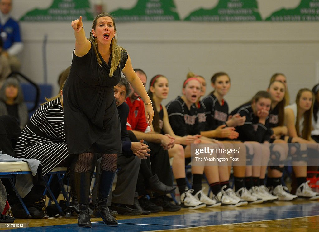 Madison's head coach Kirsten Stone shouts instructions as Madison defeats McLean 48 - 46 in the Virginia AAA Liberty District girls basketball tournament finals at South Lakes High School in Reston VA, February 15, 2012 .