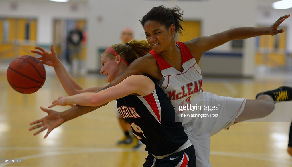 Madison's Katie Kerrigan, left, fights for a rebound with McLean's Maia Lee as Madison defeats McLean 48 - 46 in the Virginia AAA Liberty District girls basketball tournament finals at South Lakes High School in Reston VA, February 15, 2012 .