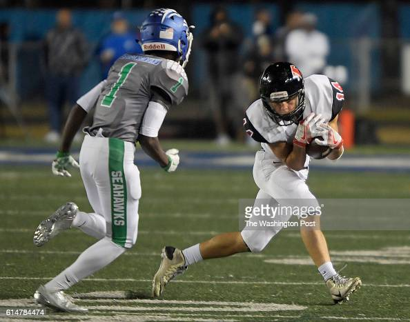 Madison's Nick Conforti right makes a reception in front of South Lakes' Dave Hagengimana during South Lakes defeat of Madison 21 13 in football at...
