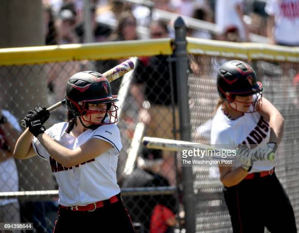 Madison's Nicole Adkins left warms up before heading to the plate during the Virginia 6A State Softball Semifinal game between Madison and Kellam at...