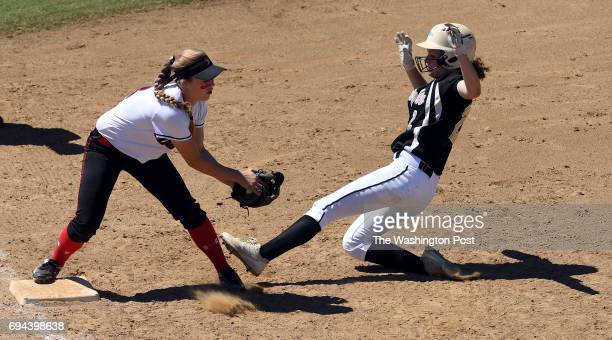 Madison's Sofia Ebersole beats Kellam's Rachel Bolin to the bag for an out during the Virginia 6A State Softball Semifinal game between Madison and...