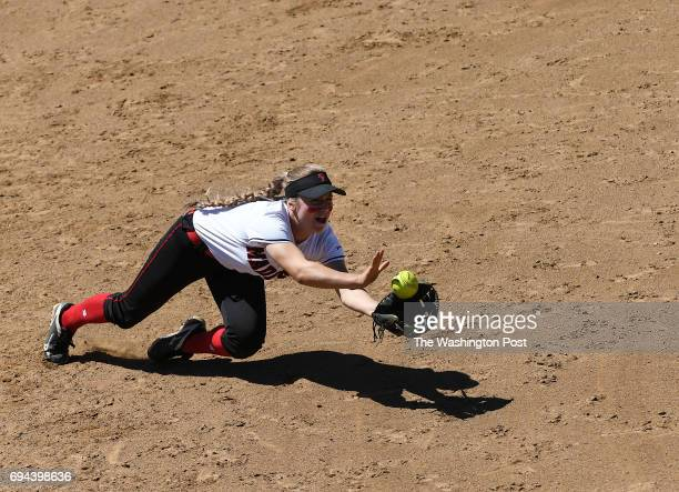 Madison's Sofia Ebersole makes a diving catch for an out during the Virginia 6A State Softball Semifinal game between Madison and Kellam at Westfield...
