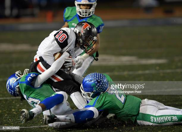Madison's Thomas MacCall is brought down by South Lakes' Donovan White left and Kojo KumiDarfour right during South Lakes' defeat of Madison in a...