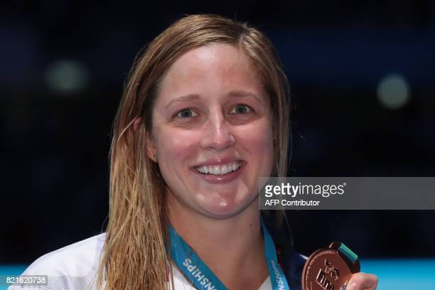 US Madisyn Cox celebrates on the podium after the women's 200m Individual Medley final during the swimming competition at the 2017 FINA World...