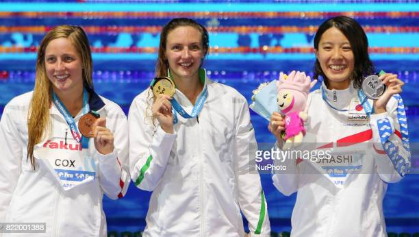 US Madisyn Cox Hungary's Katinka Hosszu and Japan's Yui Ohashi celebrate on the podium after the women's 200m Individual Medley final during the...