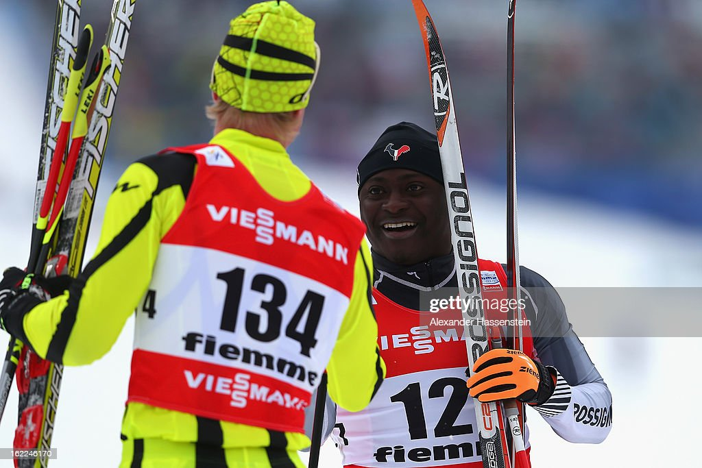 Madja Viossi-Akpedje of Togo is congratulated after competing in the Men's Cross-Country 1.5km Classic Sprint Qualification during the FIS Nordic World Ski Championships on February 21, 2013 in Val di Fiemme, Italy.