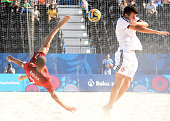 Madjer of Portugal and Sandro Spaccarotella of Switzerland fight for the balll during the Beach soccer match Portugal vs Switzerland at the Baku 2015...