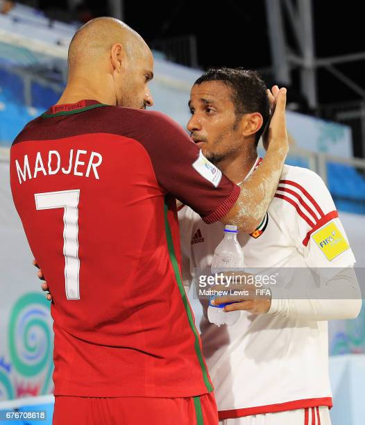 Madjer of Portugal consoles Mostafa Kiani of Iran after UAE lost to Portugal during the FIFA Beach Soccer World Cup Bahamas 2017 group C match...