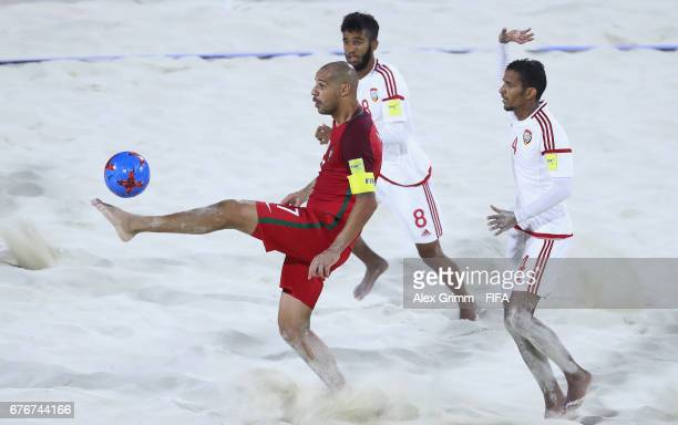 Madjer of Portugal is challenged by Ali Mohammad and Waleed Beshr of UAE during the FIFA Beach Soccer World Cup Bahamas 2017 group C match between...