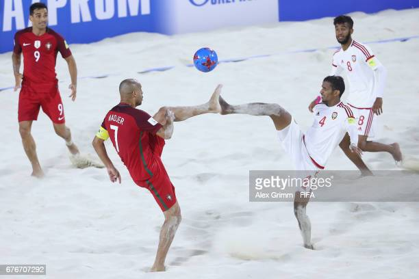 Madjer of Portugal is challenged by Waleed Beshr of UAE during the FIFA Beach Soccer World Cup Bahamas 2017 group C match between United Arab...